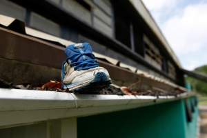 A shoe sits in the rain gutter at the MLK Center gym in McComb, Miss. By Philip Hall, Enterprise-Journal.